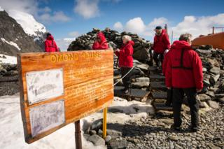 Scientists visit Omond House, Antarctica