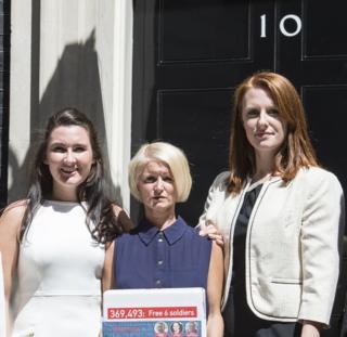 Yvonne MacHugh, Lisa Dunn and Joanne Thomlinson present a 350,000 signature petition