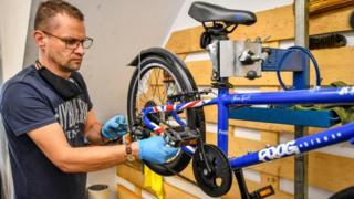 A man repairing a bike