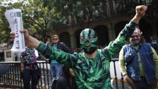 A supporter of marijuana legalisation celebrates