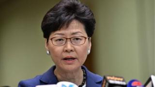 منتقدان کری لم میگویند که او سیاستهای دولت مرکزی چین را اجرا میکند