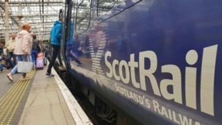 Passengers boarding train