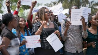 Protesters calling for the release of General Karenzi Karake outside the British High Commission in Kigali, Rwanda on 24 June 2015.