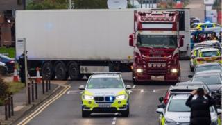 British police move the lorry container where 39 people were found dead. Photo: 23 October 2019