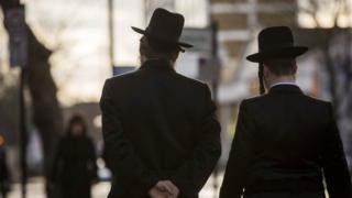 Charedi men walking in Stamford Hill, London