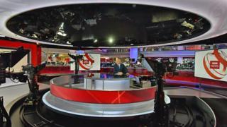 Huw Edwards presenting BBC News