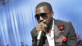 Kanye posts photos of his record deal amid dispute thumbnail