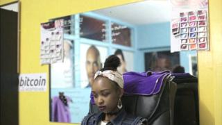 A woman at a spa that accepts Bitcoin in Nairobi