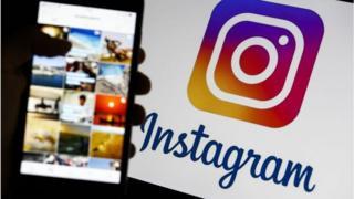 Logo de Instagram y frontal de un celular.