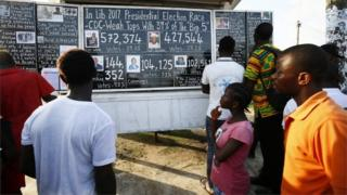 Liberians read from a 'Daily Talk'