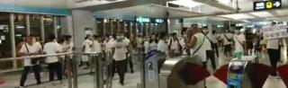 Men in white T-shirts at Yuen Long