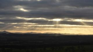 Rays of sunlight over the Scottish Borders