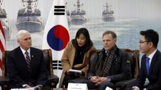 Mike Pence (L), Fred Warmbier (C) and North Korean defector Ji Seong-ho (R)
