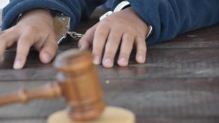 A child in handcuffs (file)