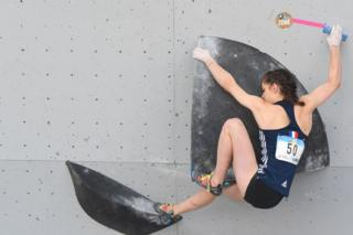 Luce Douady during a boulder climb