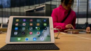 Woman used iPad at Apple store