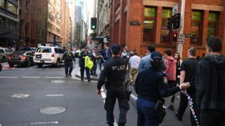 Police and witnesses at the scene of the arrest in central Sydney