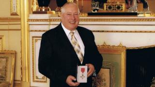 Peter Hodge with his MBE