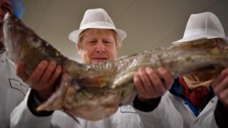 Boris Johnson holding a fish