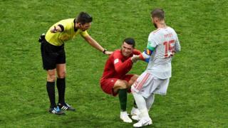 Ramos helps Ronaldo up