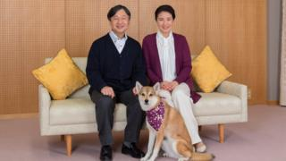 Japan's Crown Prince Naruhito and Crown Princess Masako pose for a photograph with their pet dog Yuri, 4 December 2018