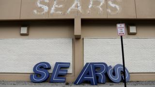 A dismantled sign sits leaning outside a Sears department store one day after it closed as part of multiple store closures by Sears Holdings Corp in the United States in Nanuet, New York, U.S., January 7, 2019.