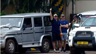 British anti-piracy crew member John Armstrong (L) gestures next to colleague Nick Simpson as they leave prison in Chennai
