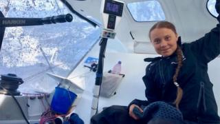 """A handout photo made available by Swedish climate activist Greta Thunberg""""s twitter account shows her onboard the racing boat Malizia II in the Atlantic Ocean, 24 August 2019"""