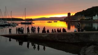 So many people out enjoying the late sunset in Oban on Sunday.