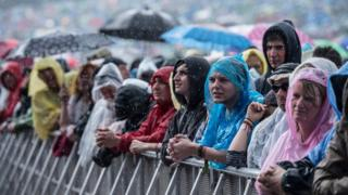 People looking happy at Glastonbury