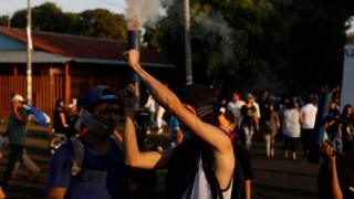 A demonstrator fires a homemade weapon during a protest against police violence and the government of Nicaraguan President Daniel Ortega in Managua, April 23, 2018