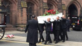 The coffin being brought out of the cathedral