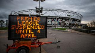 Sign showing the UK premier league is suspended until 4 April