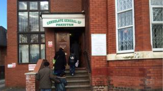 Pakistanis arriving at Consulate of Pakistan, Manchester, for consular services.