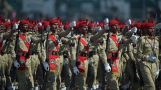 Pakistani soldiers march past during the Pakistan Day military parade in Islamabad on March 23, 2018. Pa