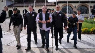 Javier Duarte (C), former governor of the Mexican state of Veracruz, is escorted by police after arriving to the Air Force compound for his extradition to Mexico, in Guatemala City, Guatemala, 17 July 17