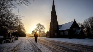 A person walks through Allerton Cemetery near Liverpool on Thursday