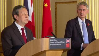 Ma Kai and Philip Hammond