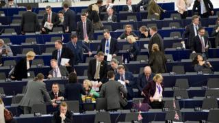 MEPs talking before a plenary sitting in Strasbourg