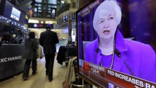 """Federal Reserve Chair Janet Yellen""""s Washington news conference is shown on a television screen on the floor of the New York Stock Exchange"""