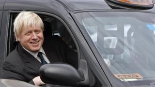 Boris Johnson sitting in a London black cab