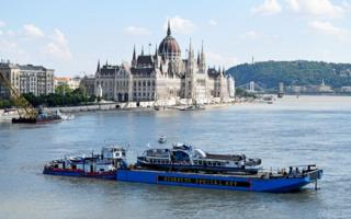 The Mermaid boat on the Danube river is moved during a salvage operation in Budapest