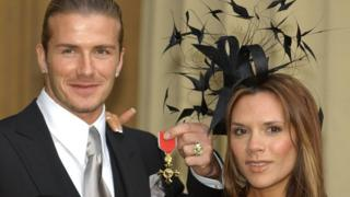 David Beckham with his wife Victoria after being made an OBE in 2003