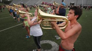 The student marching band practices on the campus of Southern Illinois University before participating in tomorrow's solar eclipse program being held at the campus football stadium on August 20, 2017 in Carbondale, Illinois. With approximately 2 minutes 40 seconds of totality the area in Southern Illinois will experience the longest duration of totality during the solar eclipse. Millions of people are expected to watch as the eclipse cuts a path of totality 70 miles wide across the United States from Oregon to South Carolina on August 21.