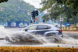 A car is seen travelling through flooded streets in Surry Hills, Sydney. 20 Jan