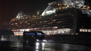 Buses ferrying American passengers to evacuation flights from a cruise ship quarantined in Japan due to coronavirus, 16 February 2020