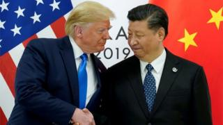 US President Donald Trump shaking hands with Chinese President Xi Jinping
