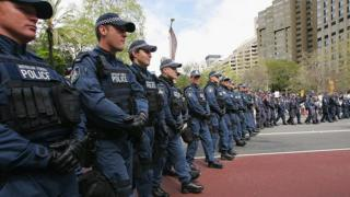 Australian Federal Police officers line up near a protest in 2007