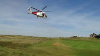The coastguard rescue helicopter comes in to land