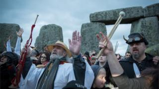 Rollo Maughfling and others gather inside the stone circle